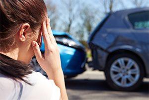 Woman looking at car crash
