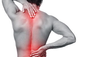 person holding back in pain