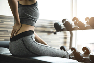 woman exercising back pain