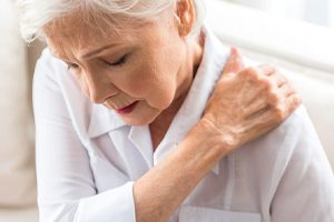 older woman upper back pain