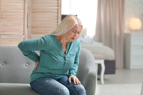 older woman lower back pain